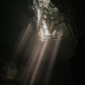 light streams into a cave from above