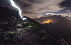 lightning strike on top of a mountain at night