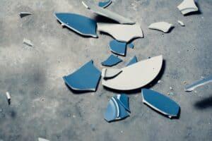 broken blue plate on floor