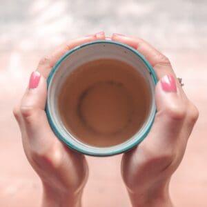 Hands hold a mug of tea