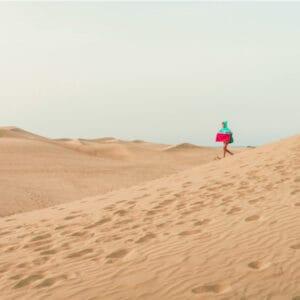 child crossing desert