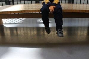 child sits on bench
