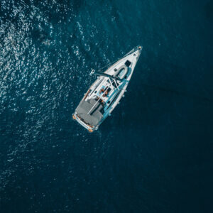 boat on a blue sea from above resilience