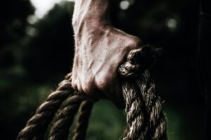 hand holds a rope