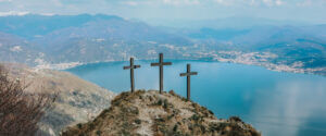 three crosses on a hill overlooking a bay