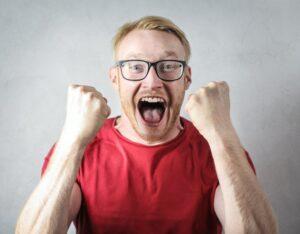 man shouts with joy