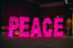 the word 'peace' spelt out in fairy lights