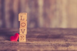 the word 'love' spelt out with alphabet blocks
